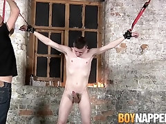 Bound twink sucking master off after some hot wax treatment