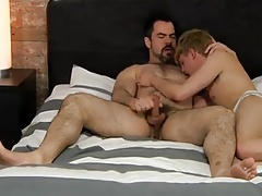 Smooth blond boy fucked by a muscular man