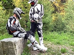 Gearbiker pissing and wanking over friend's cock